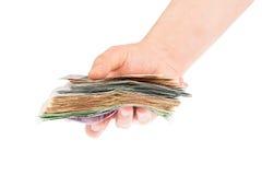Hand van geld stock foto's