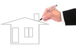 Hand van het bedrijfsmens schrijven huis uit lijn voor multifunctioneel Stock Foto