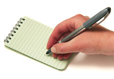 Hand van het schrijven in een notitieboekje Stock Foto's