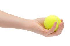 Hand van jonge het tennisbal van de meisjesholding Stock Afbeeldingen