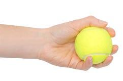 Hand van jonge het tennisbal van de meisjesholding Royalty-vrije Stock Afbeeldingen
