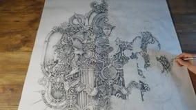 Hand van mannelijke tekening bij document prachtig patroon in zijn studio stock video
