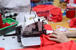 Hand van professionele naaimachine Stock Afbeelding