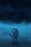 Hand van undead op blauw Stock Afbeelding
