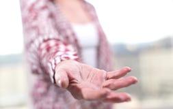 Hand van vrouw in gebaar van steun stock foto