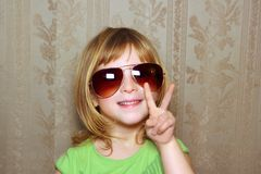 Hand victory gesture little girl funny sunglasses Royalty Free Stock Images