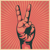 Hand with victory sign. Vector illustration in retro style of a hand with victory sign stock illustration
