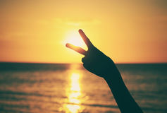 Hand with victory sign with vintage effect Royalty Free Stock Image
