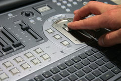 Hand on video mixer stock image