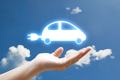 Hand and vivid car. Icon on sky Stock Image