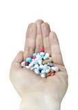 Hand voll der Pillen Lizenzfreie Stockfotos
