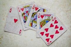 Hand von Ace u. von König Stockbilder