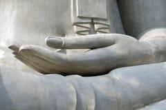 Hand von Buddha Stockfoto