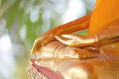 Hand von Buddha-Statue Stockfoto