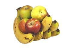 Hand von den Bananen, die fünf saftige reife Äpfel halten Lizenzfreie Stockfotos