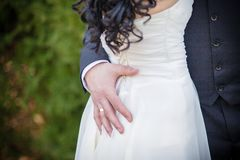 Hand on the waist of the bride Stock Image