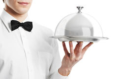 Hand of waiter with cloche lid