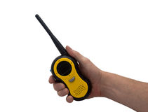 Hand & walkie talkie. An isolated over white caucasian man's hand holding and pressing a button on a walkie talkie / 2 way radio royalty free stock image