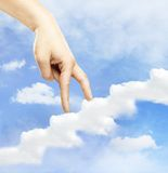 Hand walking on cloud Royalty Free Stock Images