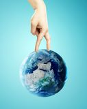 Hand walking on earth Stock Images
