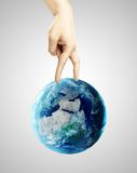 Hand walking on earth. Isolated on gray Royalty Free Stock Images