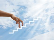 Hand walking to success stock images