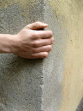 Hand on wall Royalty Free Stock Image