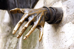 Hand in wall Stock Photography