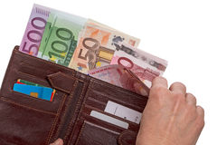 Hand  with wallet with euro banknotes Royalty Free Stock Image