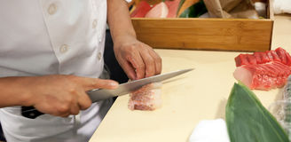 Hand was sliced fish to make sushi Royalty Free Stock Photos