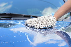 Hand wash. Ing a blue car stock image