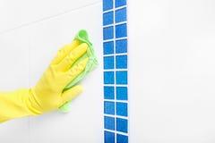 Hand wash a tile. Stock Photos