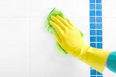 Hand wash a tile. Royalty Free Stock Photo