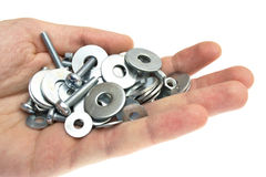 Hand with a washer, nut, screw Stock Images