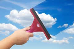 A hand washes the blue sky. Blue clear sky Royalty Free Stock Images
