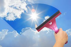 A hand washes the blue sky. Blue clear sky Stock Photo