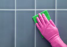 Hand washes the tile. royalty free stock images