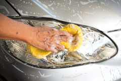 Hand washing car. Royalty Free Stock Photography