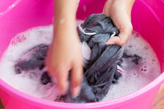 Hand Washing Clothes Stock Photo