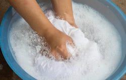 Hand washing clothes Stock Photos