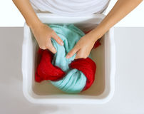 Hand washing of color laundry Royalty Free Stock Photo