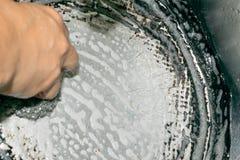 Hand washing frying pan pot Royalty Free Stock Photos