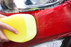 Hand Washing Red Car With Yellow Sponge Royalty Free Stock Photography