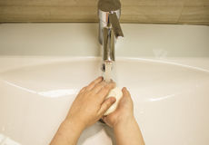 Hand washing 2. Hand washing with soap in the bathroom Stock Photos