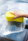 Hand Washing Windscreen With Yellow Sponge Royalty Free Stock Photos