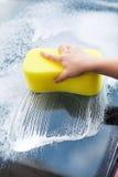 Hand Washing Windscreen With Yellow Sponge Royalty Free Stock Photos
