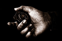 Hand with a watch. Hand with stop watch - the hands are rough and the processing is creepy Stock Images