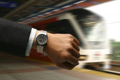 Hand with watch with LRT background Royalty Free Stock Image