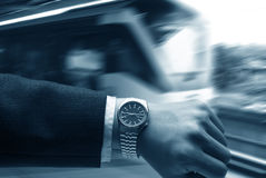 Hand with watch with LRT background Stock Photos