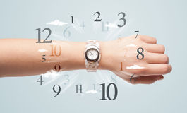 Hand with watch and numbers on the side comming out Stock Photos